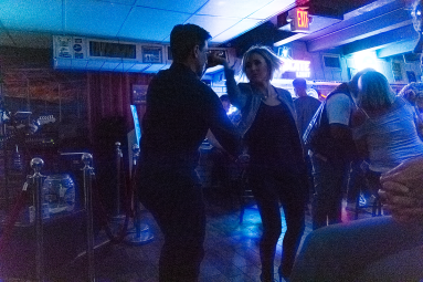 Here is the same guy dancing with one of the many ladies that night.